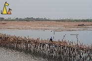 Bamboo bridge, Kampong Cham, Cambodia, Girl cycling, bamboo bridge, Cambodia