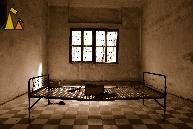 Cell at S-21, Tuol Sleng, Phnom Penh, Cambodia, Tuol Sleng Genocide Museum, S-21, bed, cell, Khmer Rouge, sepia