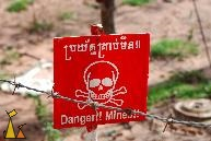 Landmine warning sign, Landmine museum, Siem Reap, Cambodia, sign, warning, landmine, scull and bones, TM-57, barbwire