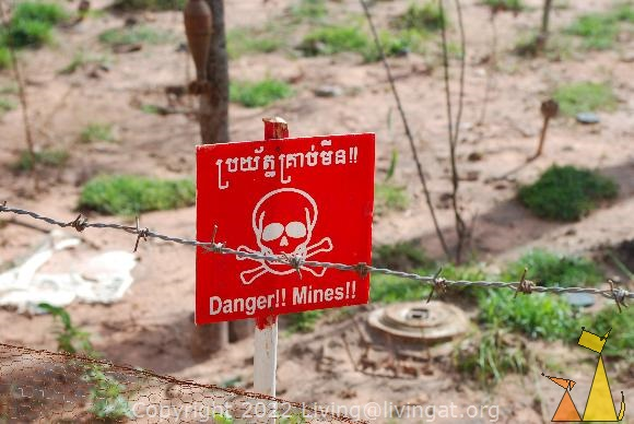 Landmine warning sign, Landmine museum, Siem Reap, Cambodia, sign, warning, landmine, scull and bones, TM-57, barbwire, 82mm shell, 82mm