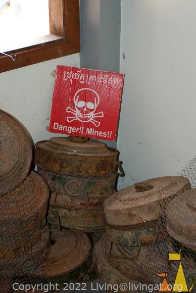 Pile of Death, Landmine museum, Siem Reap, Cambodia, sign, landmine warning, anti-tank, mine, TM-56, TM-57