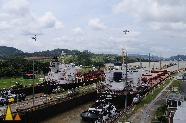 Ships in the Locks, Miraflores, Panama Canal, Panama, ship, train, railroad, lock, canal, tug boat, bridge