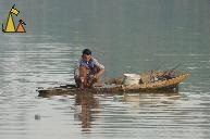 Smoking Fisherman, Battambang, Cambodia, smoking, man, fishing, net, boat
