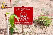 Squared up minefield, Landmine museum, Siem Reap, Cambodia, sign, warning, landmine, scull and bones, minefield, anti-personal mine