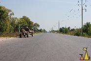 Straight road, Sisophon, Cambodia, tractor, straight road, electrical poles